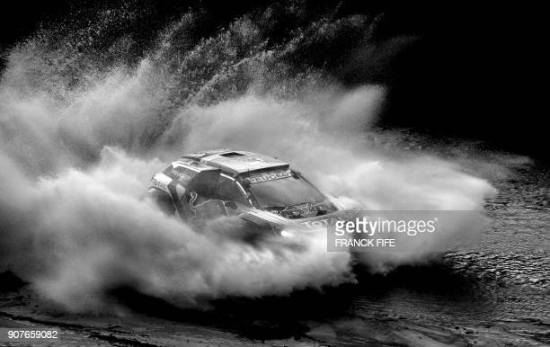 Peugeot's Spanish driver Carlos Sainz and codriver Lucas Cruz of Spain compete during the Stage 12 of the 2018 Dakar Rally between Chilecito and San...