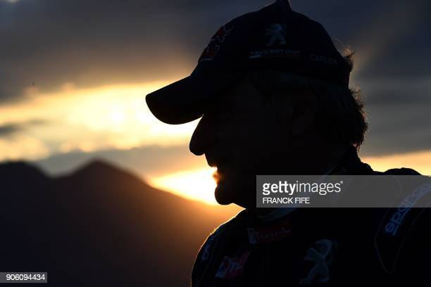 Peugeot's Spanish driver Carlos Sainz awaits for the start of the Stage 11 of the 2018 Dakar Rally between Belen and Chilecito, in Argentina, on...