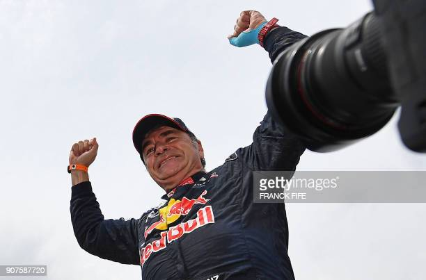 Peugeot's Spanish driver Carlos Sainz celebrates after winning the Dakar Rally 2018 at the end of the last stage in and around Cordoba province in...