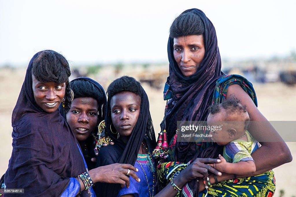 Peul nomad girls watching the Gerewol Festival Sahel Niger : Stock Photo