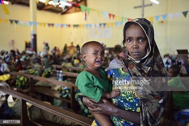 A Peul woman holds her child as she takes shelter in the Boali church on January 19 in Boali some 100km north of Bangui Fresh fighting broke out in...