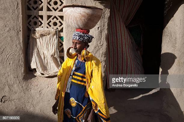 Peul woman wearing traditional gold earrings in the Taikiri neighborhood on January 22 2010 in Mopti Mali Mopti is a town in the Inner Niger Delta...