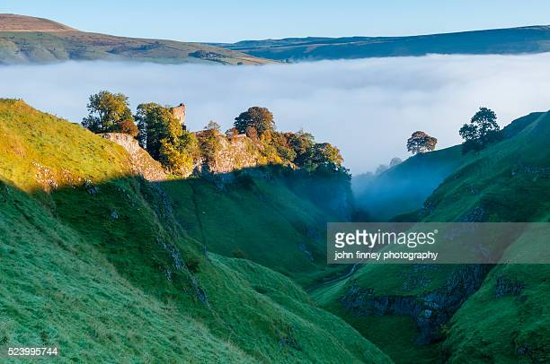 Peveril Castle and Cave Dale Autumn sunrise, Castleton, English Peak District. UK. Europe.