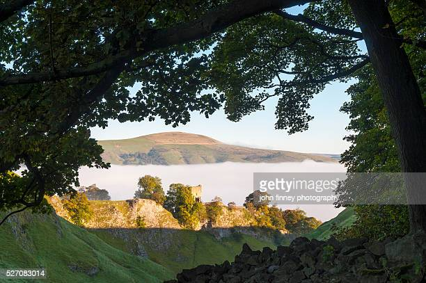 peveril castle framed with an oak tree, autumn sunrise, castleton, english peak district. uk. europe. - peveril castle stock pictures, royalty-free photos & images