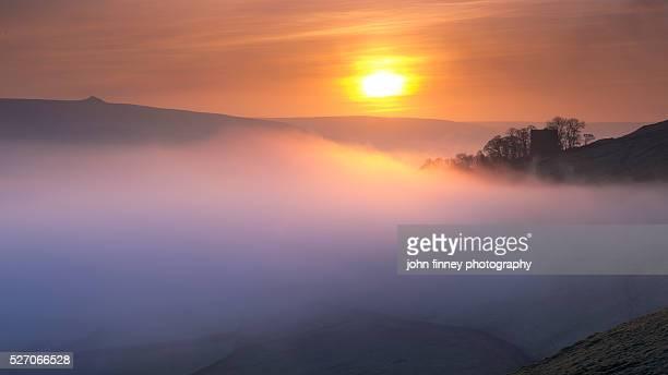 Peveril Castle misty Autumn sunrise, Castleton, English Peak District. UK. Europe.