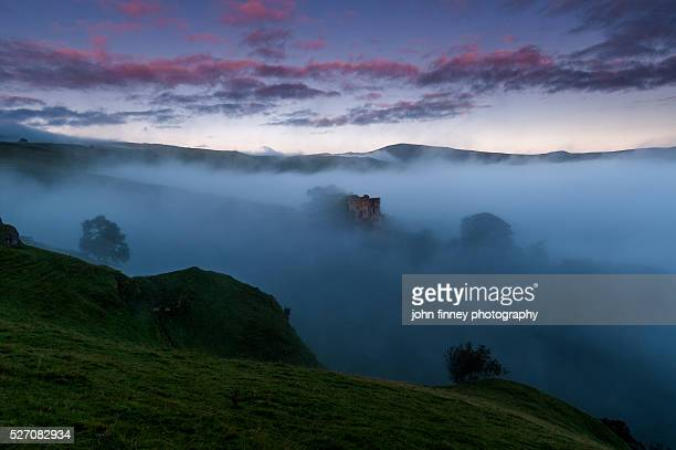 Peveril Castle misty dawn, Castleton, English Peak District. UK. Europe.
