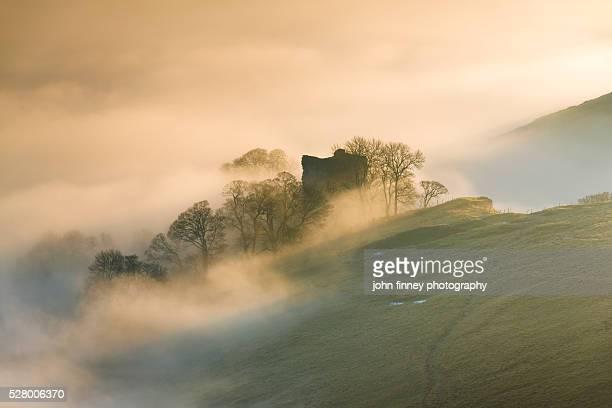 Peveril Castle, misty sunrise, Castleton, English Peak District. UK. Europe.