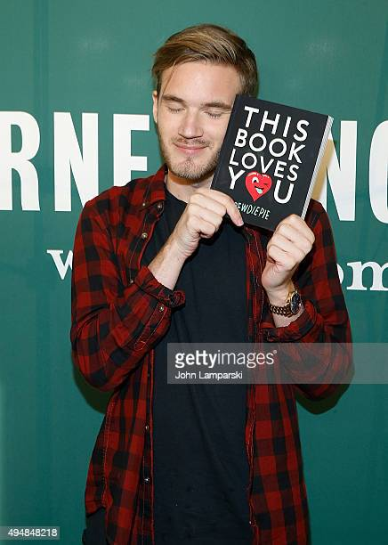 Pewdiepie pictures and photos getty images pewdiepie signs copies of his new book this book loves you at barnes noble m4hsunfo