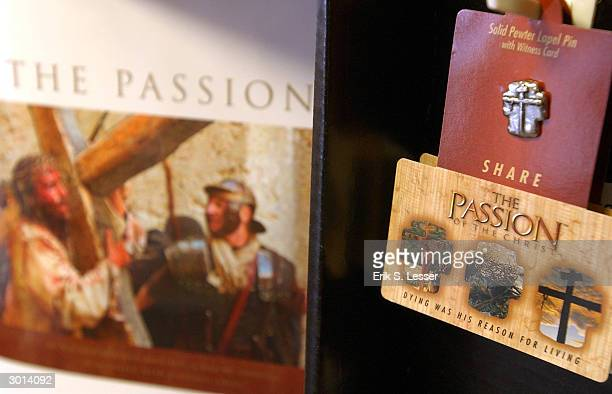 A pewter lapel pin and book for sale at a The Passion of the Christ merchandise display at Family Christian Stores February 25 2004 in Atlanta...