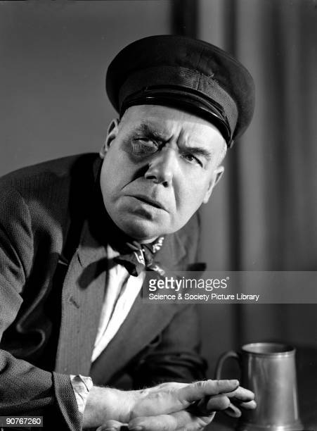 A pewter tankard stands on the bar the man is leaning against Some photographs by Photographic Advertising suggest emotions mood or character...