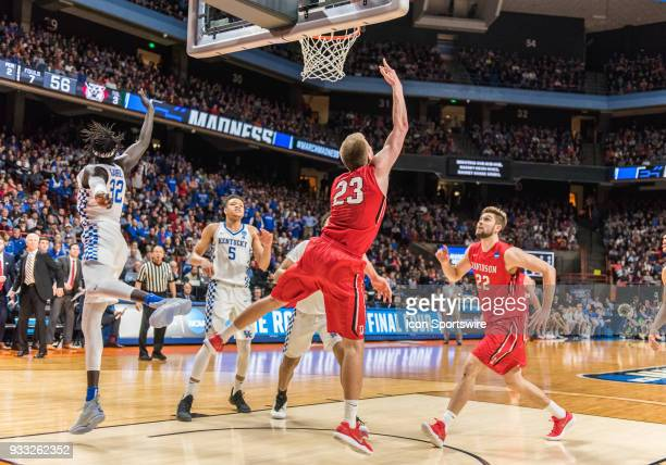 Peyton Aldridge of the Davidson Wildcats does a reverse lay up under the basket during the NCAA Division I Men's Championship First Round game...