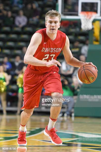 Peyton Aldridge of the Davidson Wildcats dribbles the ball during a college basketball game against the George Mason Patriots at the Eagle Bank Arena...