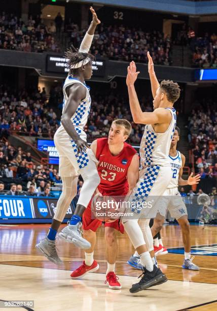 Peyton Aldridge of the Davidson Wildcats gets squeezed between F Wenyen Gabriel of the Kentucky Wildcats and F Kevin Knox of the Kentucky Wildcats in...