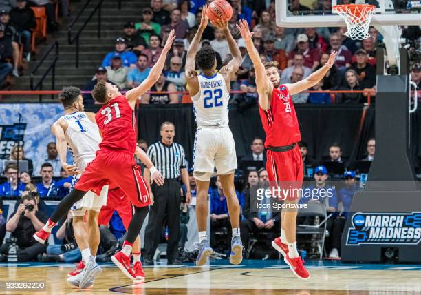 Peyton Aldridge of the Davidson Wildcats goes up in front of G Shai GilgeousAlexander of the Kentucky Wildcats during the NCAA Division I Men's...