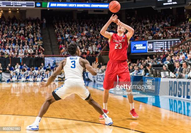 Peyton Aldridge of the Davidson Wildcats grabs the ball back after being dislodged by G Hamidou Diallo of the Kentucky Wildcats during the NCAA...