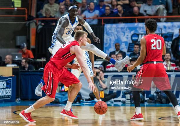 Peyton Aldridge of the Davidson Wildcats moves past F Wenyen Gabriel of the Kentucky Wildcats during the NCAA Division I Men's Championship First...
