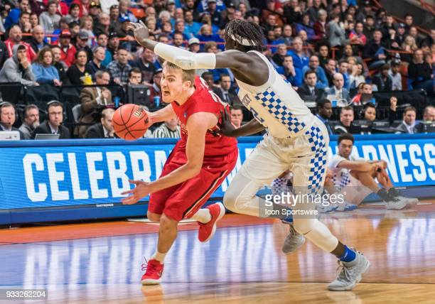 Peyton Aldridge of the Davidson Wildcats pushes past F Wenyen Gabriel of the Kentucky Wildcats during the NCAA Division I Men's Championship First...