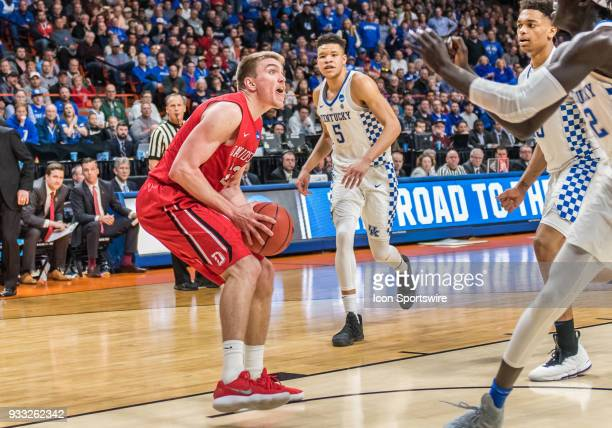 Peyton Aldridge of the Davidson Wildcats stops as Kentucky Wildcats defenders rush in to block his shot during the NCAA Division I Men's Championship...