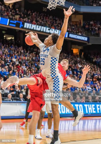 Peyton Aldridge of the Davidson Wildcats takes a fall under the basket after a block by F PJ Washington of the Kentucky Wildcats during the NCAA...