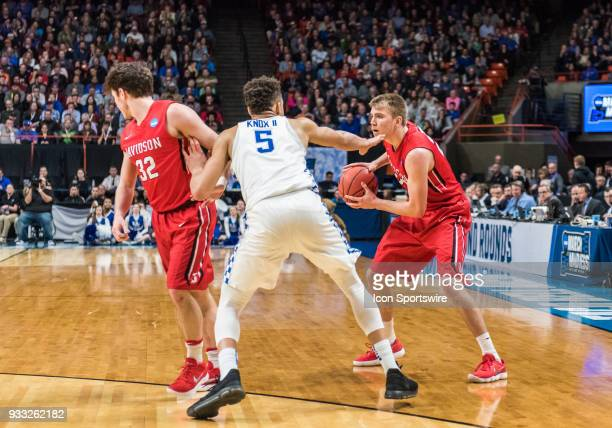 Peyton Aldridge of the Davidson Wildcats tries to move around a screen set up by G Rusty Reigel of the Davidson Wildcats during the NCAA Division I...