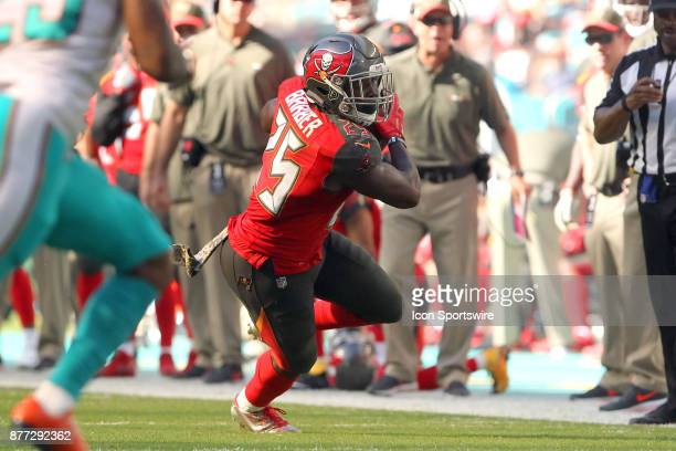 Peyton Barber of the Bucs carries the ball during game between the Tampa Bay Buccaneers and the Miami Dolphins on Sunday Nov 19 2017 at Hard Rock...
