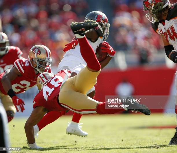 Peyton Barber of the Tampa Bay Buccaneers breaks through the San Francisco 49ers defense during the game at Raymond James Stadium on November 25 2018...