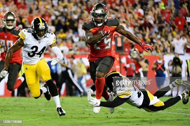 Peyton Barber of the Tampa Bay Buccaneers runs for 18 yards to set up a touchdown in the firs quarter against the Pittsburgh Steelers on September 24...