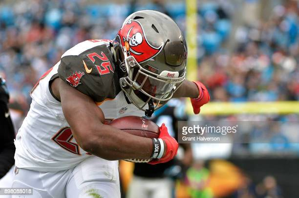 Peyton Barber of the Tampa Bay Buccaneers runs the ball against the Carolina Panthers in the first quarter at Bank of America Stadium on December 24...