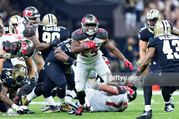 Peyton Barber of the Tampa Bay Buccaneers runs the ball during a game against the New Orleans Saints at MercedesBenz Superdome on November 5 2017 in...