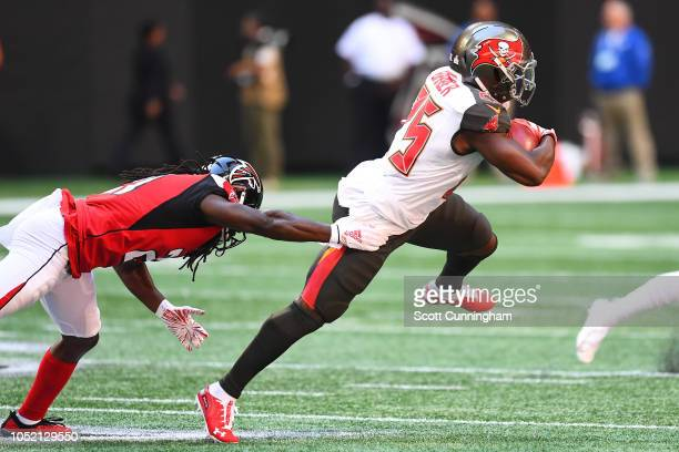 Peyton Barber of the Tampa Bay Buccaneers runs the ball during the first quarter against the Atlanta Falcons at MercedesBenz Stadium on October 14...