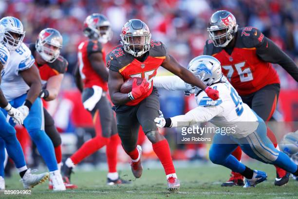 Peyton Barber of the Tampa Bay Buccaneers runs the ball near the goal line to set up a touchdown against the Detroit Lions in the fourth quarter of a...