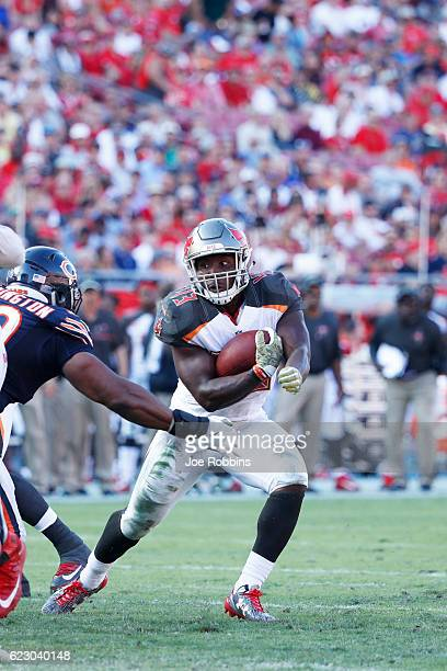 Peyton Barber of the Tampa Bay Buccaneers runs with the ball against the Chicago Bears in the second half of the game at Raymond James Stadium on...