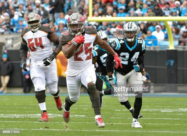 Peyton Barber of the Tampa Bay Buccaneers rus against the Carolina Panthers during their game at Bank of America Stadium on December 24 2017 in...