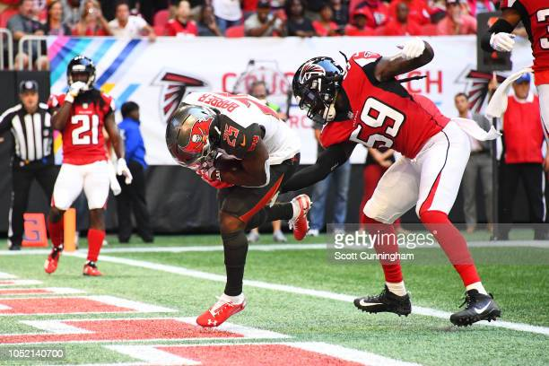 Peyton Barber of the Tampa Bay Buccaneers scores a touchdown during the fourth quarter against De'Vondre Campbell of the Atlanta Falcons at...