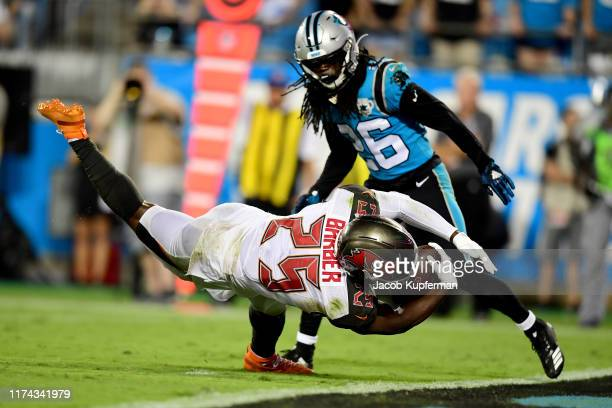 Peyton Barber of the Tampa Bay Buccaneers scores a touchdown in the third quarter during their game against the Carolina Panthers at Bank of America...
