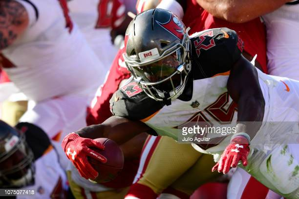 Peyton Barber of the Tampa Bay Buccaneers stretches for a touchdown during the first half against the San Francisco 49ers at Raymond James Stadium on...