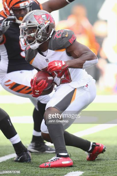 Peyton Barber of the Tampa Bay Bucccaneers runs the football upfield during the game against the Cincinnati Bengals at Paul Brown Stadium on October...