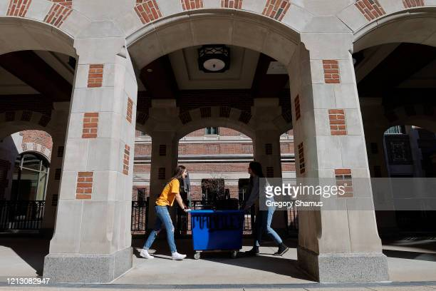 Peyton Grant of Lavallette, New Jersey and Lizzy Anderson of White Pigeon Michigan pack up and move out of their dorm at the University of Michigan...