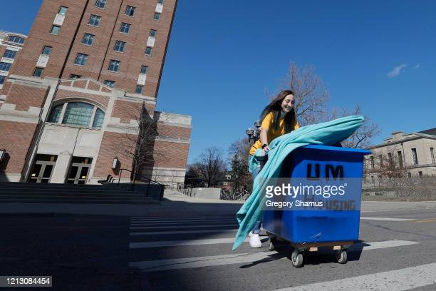 Peyton Grant of Lavallette, New Jersey pack up and moves out of her dorm at the University of Michigan on March 17, 2020 in Ann Arbor, Michigan....