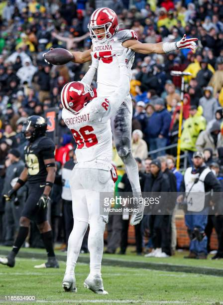 Peyton Hendershot and Zach Merrill of the Indiana Hoosiers celebrate during the overtime period against the Purdue Boilermakers at Ross-Ade Stadium...