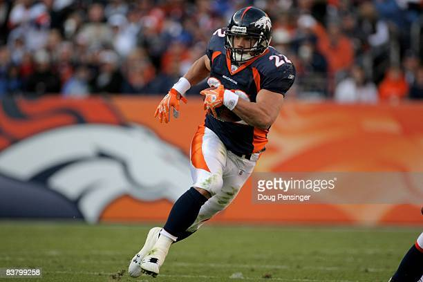Peyton Hillis of the Denver Broncos rushes against the Oakland Raiders during week 12 NFL action at Invesco Field at Mile High on November 23 2008 in...