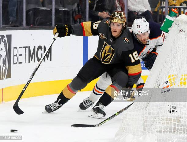 Peyton Krebs of the Vegas Golden Knights controls the puck against Leon Draisaitl of the Edmonton Oilers in the second period of their game at...