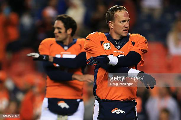 Peyton Manning and Brock Osweiler of the Denver Broncos stretch prior to their game against the Kansas City Chiefs at Sports Authority Field at Mile...