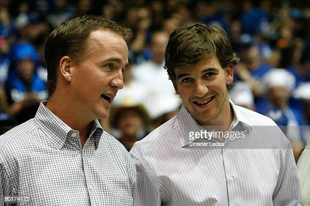 Peyton Manning and brother Eli Manning watch on at the Duke Blue Devils versus North Carolina Tar Heels during their game at Cameron Indoor Stadium...