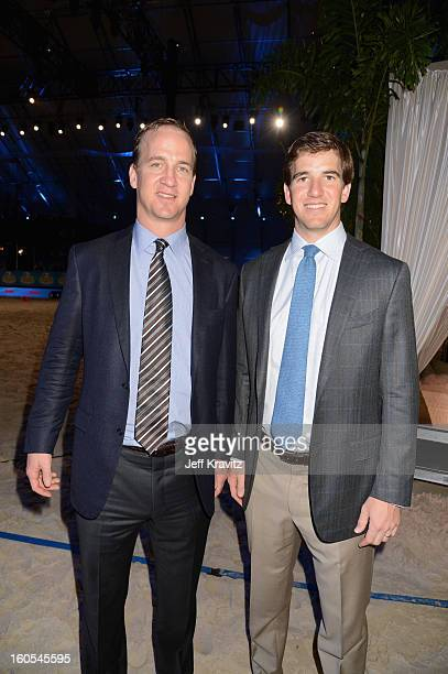 Peyton Manning and Eli Manning attend DIRECTV'S 7th Annual Celebrity Beach Bowl at DTV SuperFan Stadium at Mardi Gras World on February 2 2013 in New...