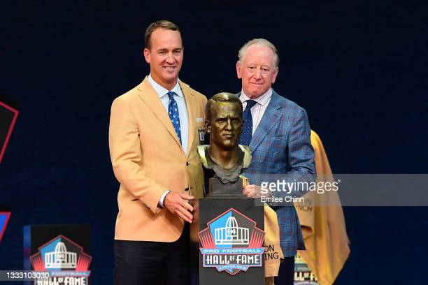 Peyton Manning and his father Archie Manning pose after unveiling his bust during the NFL Hall of Fame Enshrinement Ceremony at Tom Benson Hall Of...