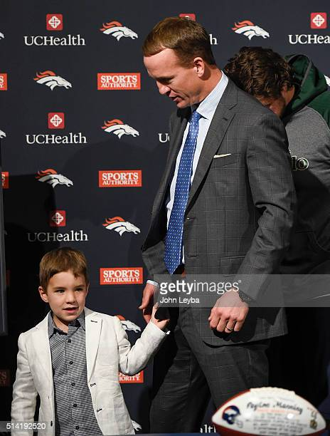 Peyton Manning and his son Marshall 4 yearsold head off the podium after his retirement speech The Denver Broncos hold a press conference to announce...