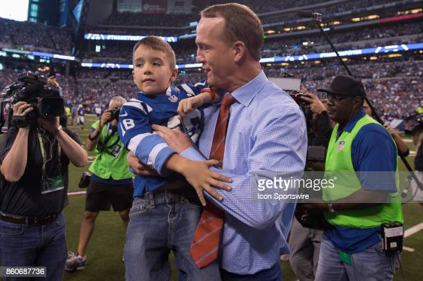 Peyton Manning and his son Marshall during the ceremony for the retired jersey of Peyton Manning during the NFL game between the San Francisco 49ers...