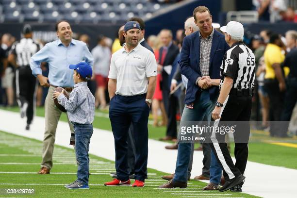 Peyton Manning and referee Walt Coleman shake hands before the game between the Houston Texans vs New York Giants at NRG Stadium on September 23 2018...