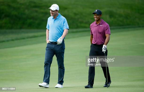 Peyton Manning and Tiger Woods walk down the fairway on the second hole during the ProAm of The Memorial Tournament Presented By Nationwide at...